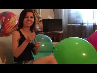CHICK BLOWS BALLOON AND POP IT bunch of balloons around her