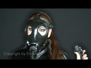Latex catsuit girl in gasmask