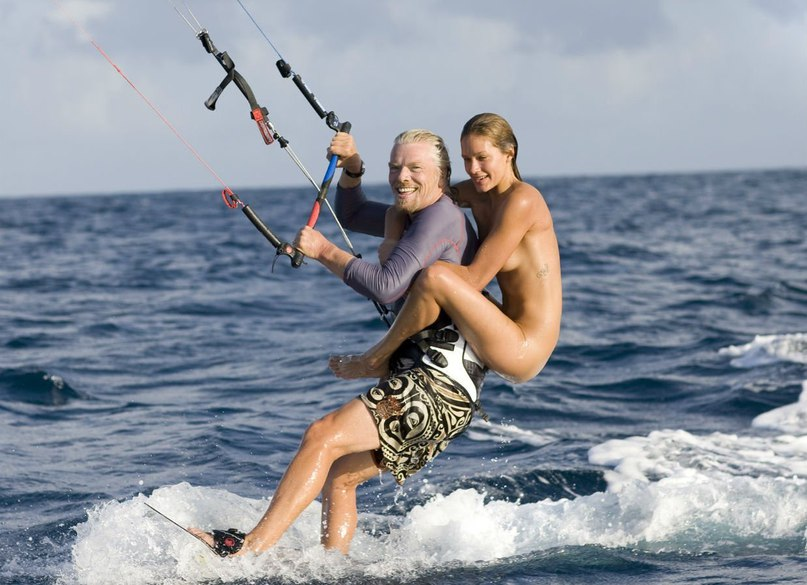 Richard branson goes kiteboarding with girls on his back