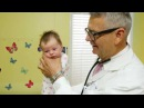 How To Calm A Crying Baby - Dr. Robert Hamilton Demonstrates The Hold (Official)