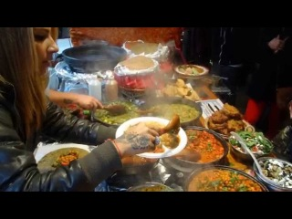 Indian / Turkish Fusion Street Food wraps at Roti Roll stall in Sunday UpMarket, Brick Lane, London.