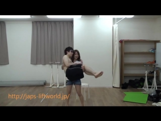 Cute japanese girl lift and carry guy
