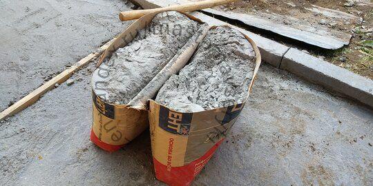 Как быстро и без пыли разделить мешок цемента пополам.