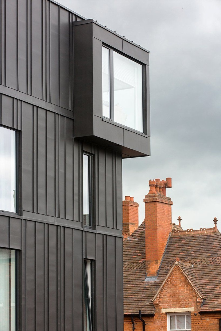 BPN architects adds zinc-clad residences to birmingham's school yard development