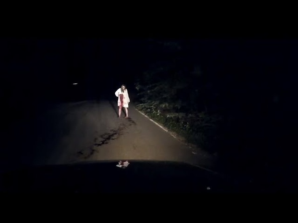 Horror! The video recorder caught on the road at night a bloody woman who stabbed herself in the sto