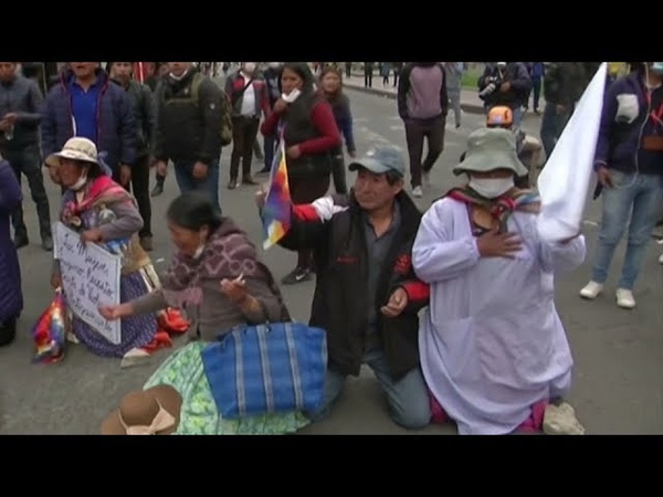 Morales' supporters clash with Bolivian police as interim government takes office